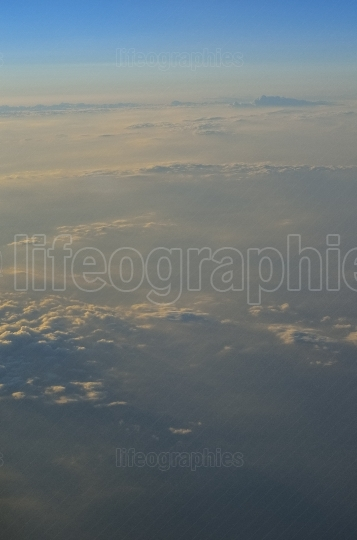 Earth and clouds seen from the plane through window