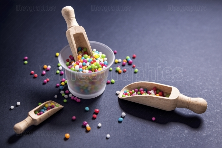 Edible sugar pearls for food decoration with wood scoops