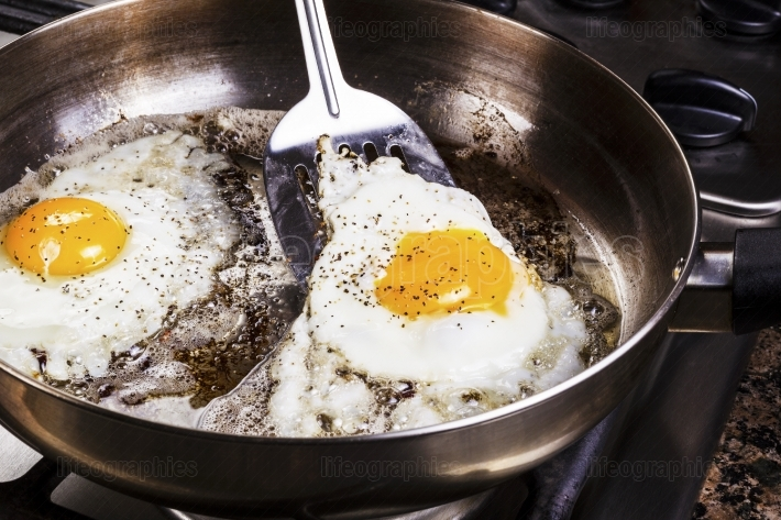 Eggs cooked with bacon grease in pan