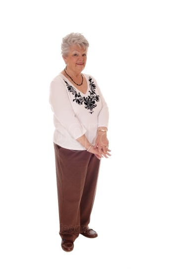 Elderly woman standing full body.