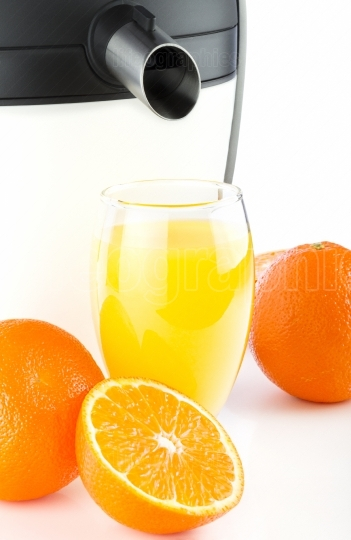 Electric juicer making orange juice