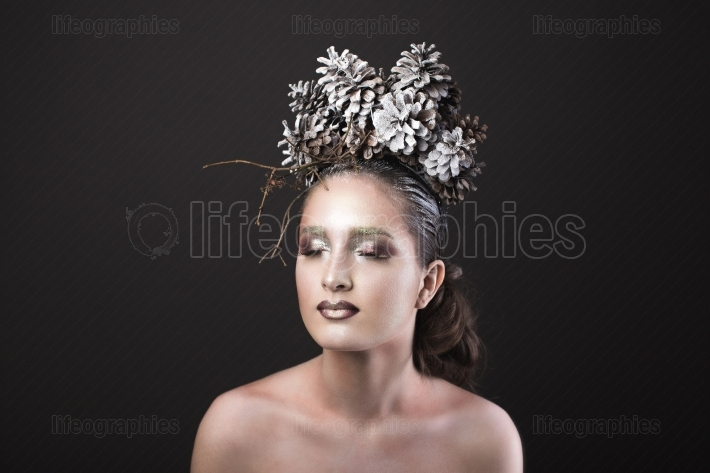 Elegant Girl in the New Year Wreath of Pine Cones