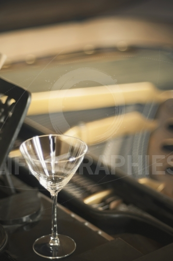Empty glass on a piano