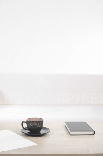Empty sofa with coffee cup