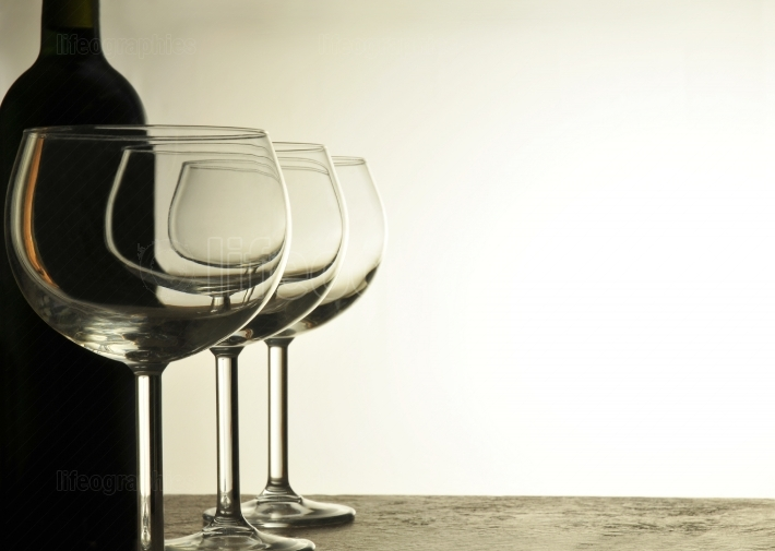 Empty Wine Glasses and Bottle
