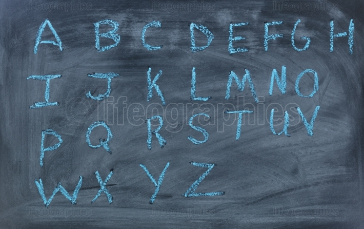 English alphabet letters written on chalk board