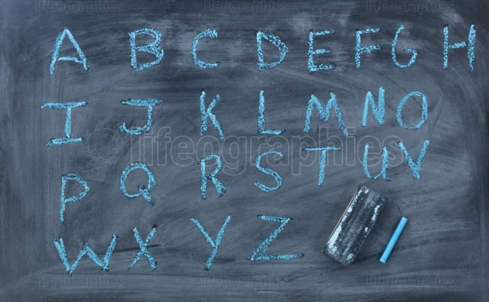 English alphabet letters written on chalk board with eraser