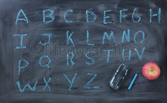 English alphabet letters written on chalk board with eraser and