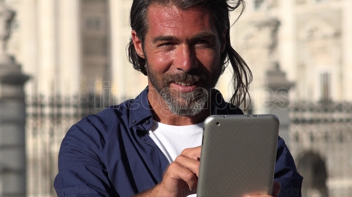 European Male Using Tablet