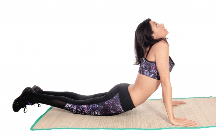 Exercising woman on a mat