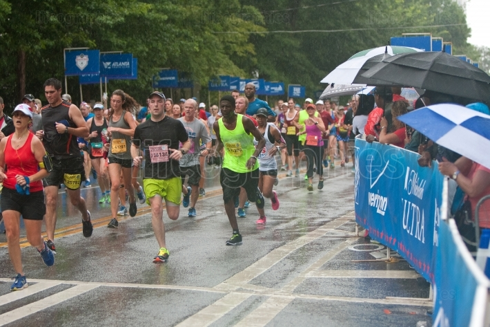 Exhausted runners approach finish line at atlanta peachtree road