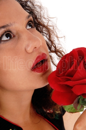 Face of woman with red rose.