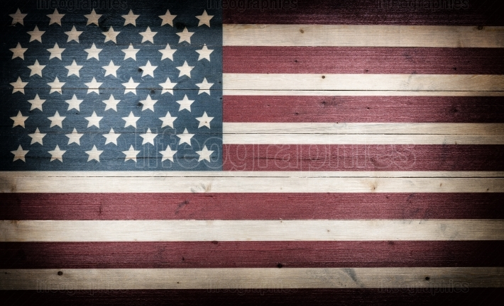 Fading USA flag painted on faded wooden boards