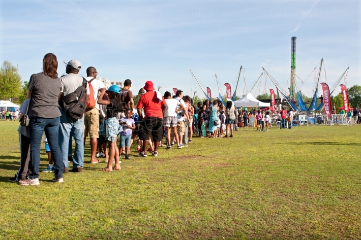 Families Stand In Long Line Waiting For Atlanta Festival Ride