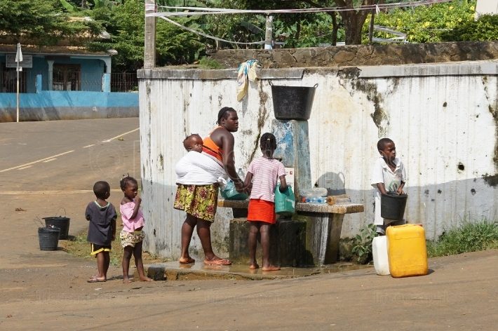 Family on public water pump, Santana, Sao Tome