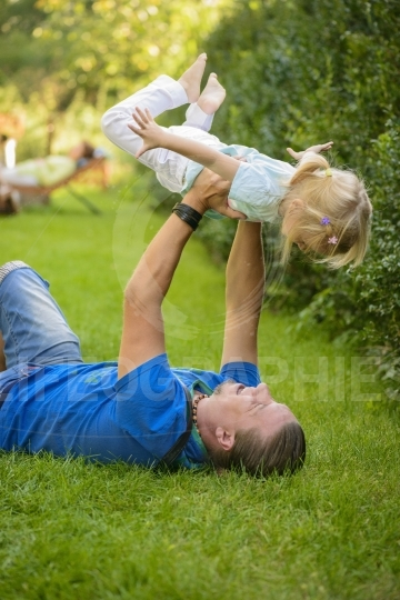 Father and daughter playing outdoor