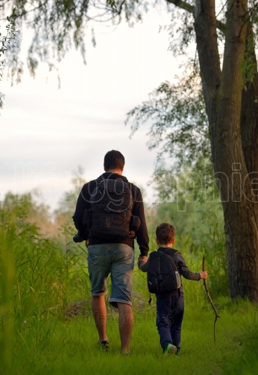 Father and son on path