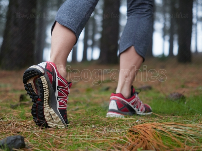 Feet of young woman hiking  Concept of trip and adventure