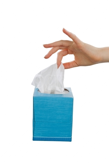 Female handing pulling soft facial tissue from napkin box