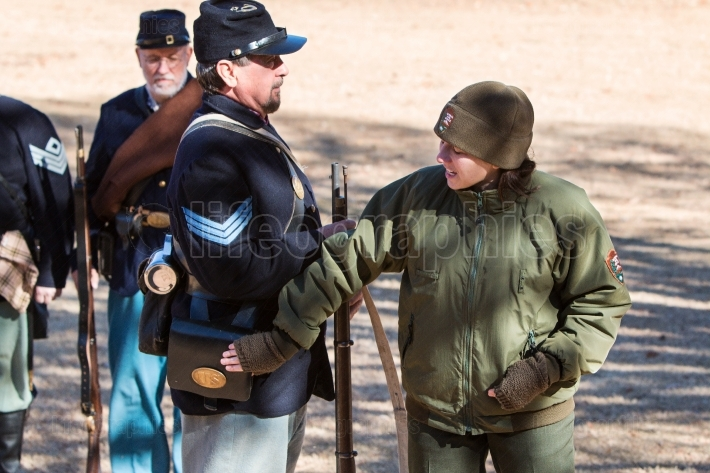 Female park ranger explains union soldier uniform at firing demo