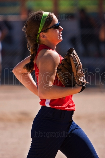 Female softball player runs off the field