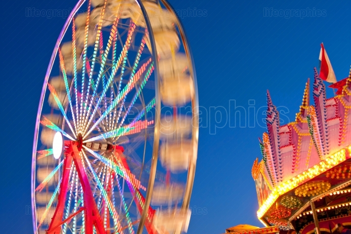 Ferris Wheel Circular Movement Motion Blurs Against Blue Twiligh