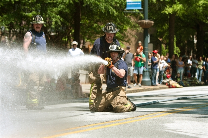 Firemen Shoot Water At Target In Atlanta Muster Competition