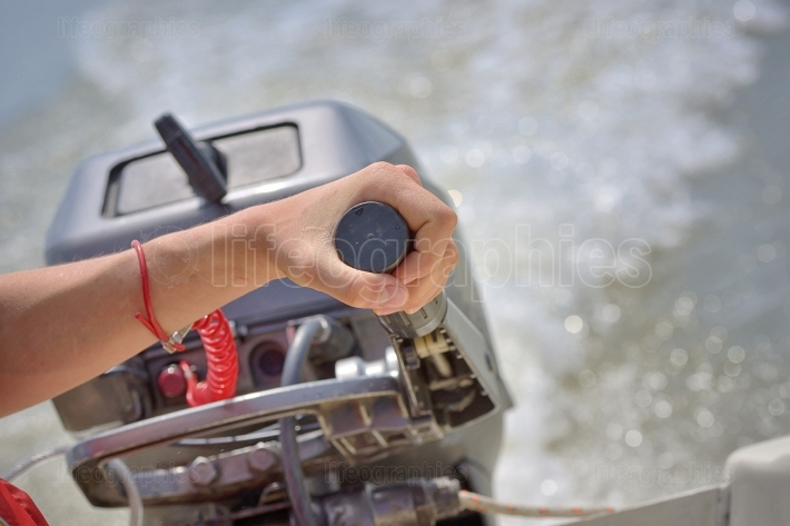 Fisherman hand and boat engine