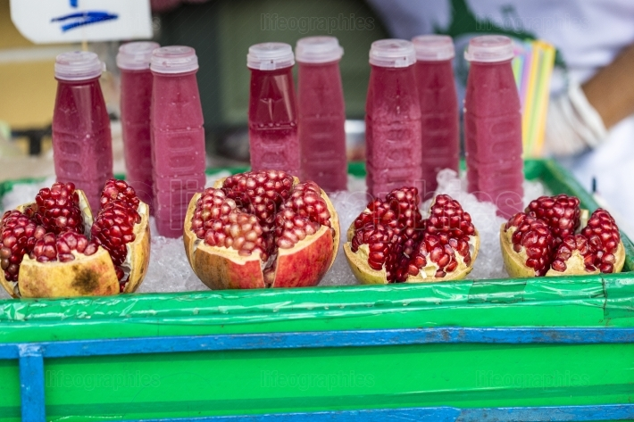 Food street pomegranate raw and pomegranate juice in china town