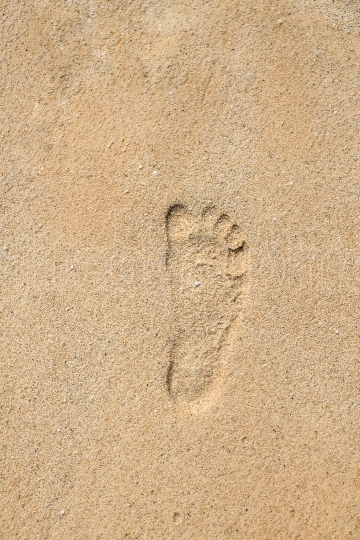 Footprint on the sand at Marble Beach, Thassos island, Greece