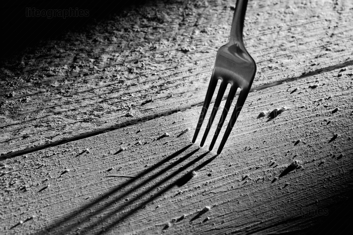 Fork on wood table