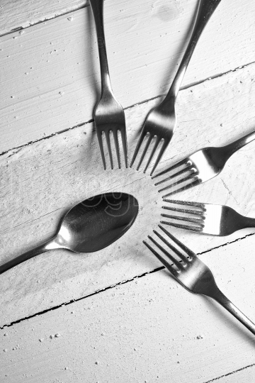 Forks and spoon on wood table