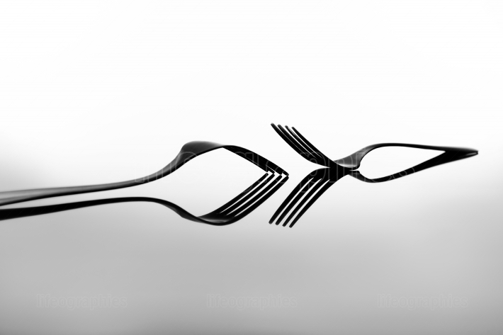 Forks on glossy table surface