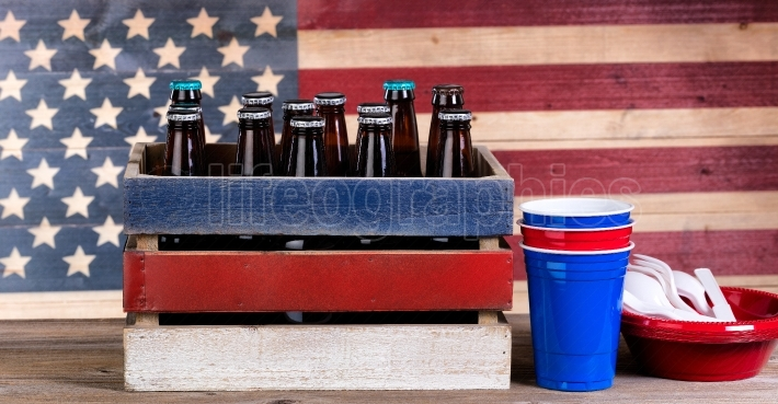 Fourth of July with beer and party items on rustic wood