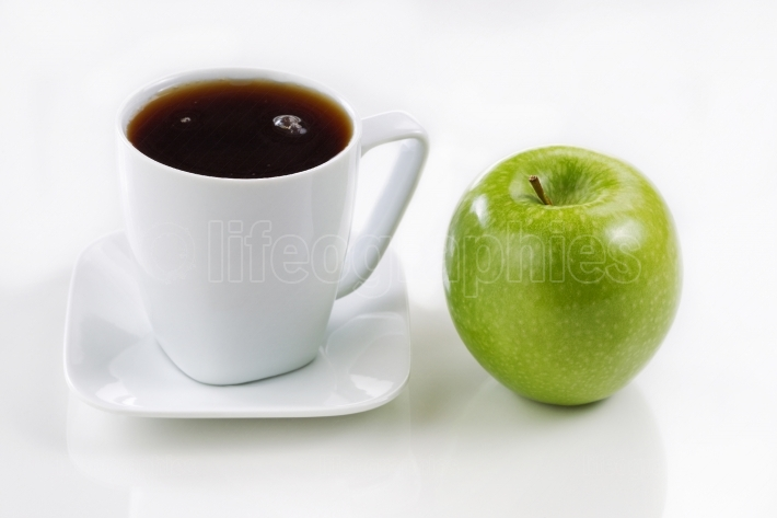 Fresh apple and coffee for morning breakfast