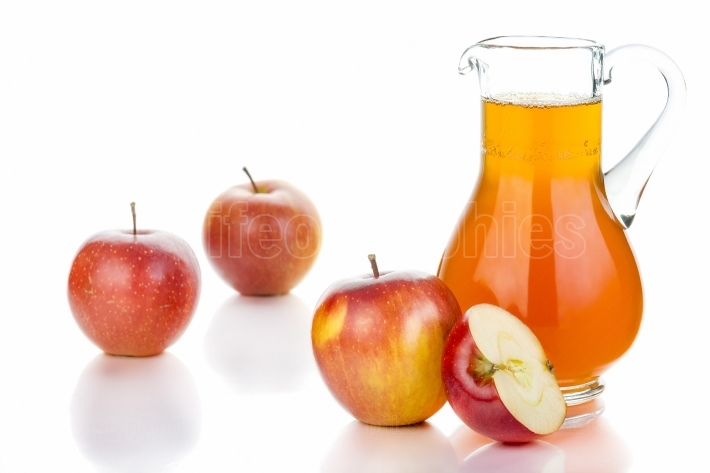 Fresh apples, glass with juice on white background