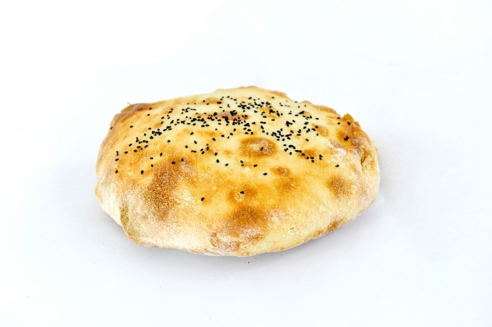 Fresh baked bread on a white background