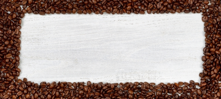 Fresh Coffee Beans on White Wood