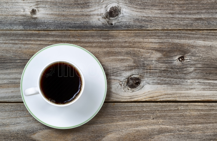 Fresh Coffee in Cup and saucer on aged wood