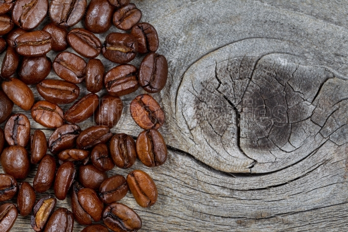 Fresh Roasted Coffee Beans on Rustic Wood