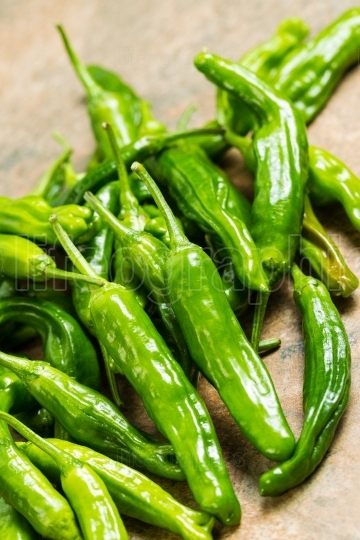 Fresh Sweet Green Peppers stacked in a pile