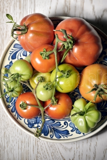 Fresh tomatoes on plate
