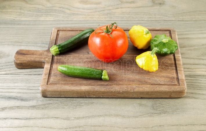 Fresh Vegetables on Aged Wooden Board