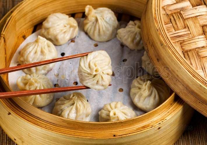Freshly steamed Chinese dumplings out of bamboo steamer ready to