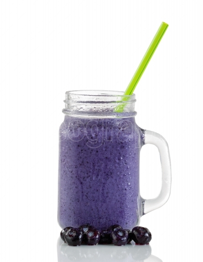 Frosted blueberry smoothie isolated on white background