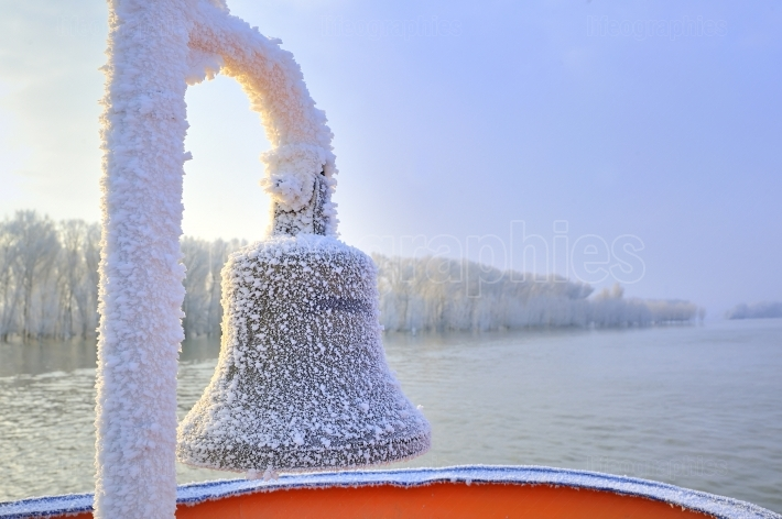 Frozen ship bell in winter time