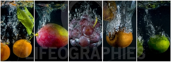 Fruits and vegetables falling into the water with splashes