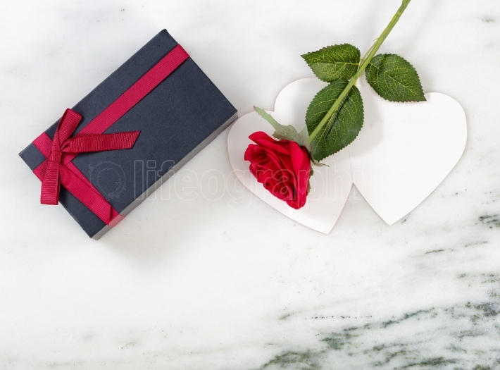 Gifts of Care for the holiday season on marble stone background
