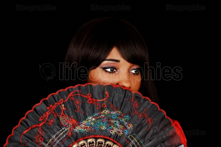 Girl behind fan