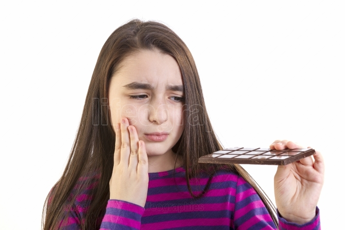 Girl child with toothache